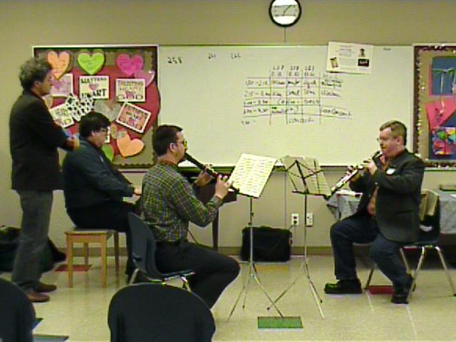 Daniel Bruggen instructs an ensemble. [Dallas Recorder Society workshop and concert with the Amsterdam Loeki Stardust Recorder Quartet - Dallas, TX, Feb. 28-29, 2004]
