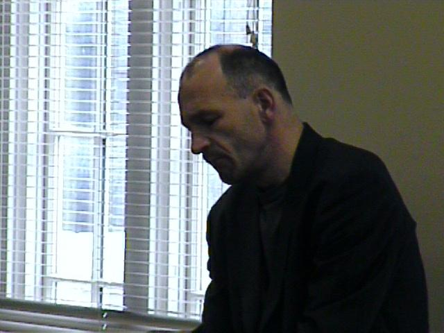 Bertho Driever listens to a student's performance. [Dallas Recorder Society workshop and concert with the Amsterdam Loeki Stardust Recorder Quartet - Dallas, TX, Feb. 28-29, 2004]