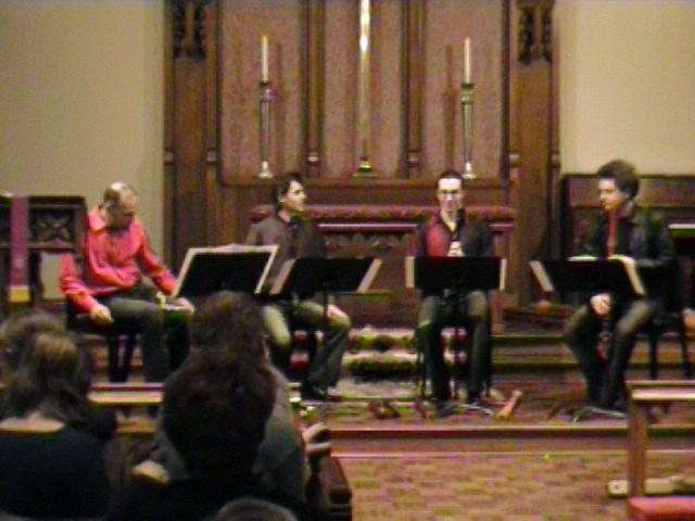 The Amsterdam Loeki Stardust Quartet prepares to begin playing. [Dallas Recorder Society workshop and concert with the Amsterdam Loeki Stardust Recorder Quartet - Dallas, TX, Feb. 28-29, 2004]